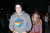 Mike Comrie wore a surf-inspired sweatshirt to dinner.
