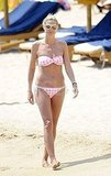 Heidi Klum wears a bikini on the beach.