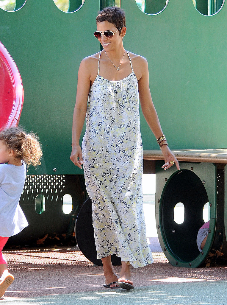 Reason 4: Even though she looks great in body-con silhouettes, she looks even dreamier by day in flowy floral maxi dresses.