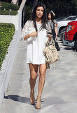 Kourtney Kardashian navigated the sidewalk in high heels.