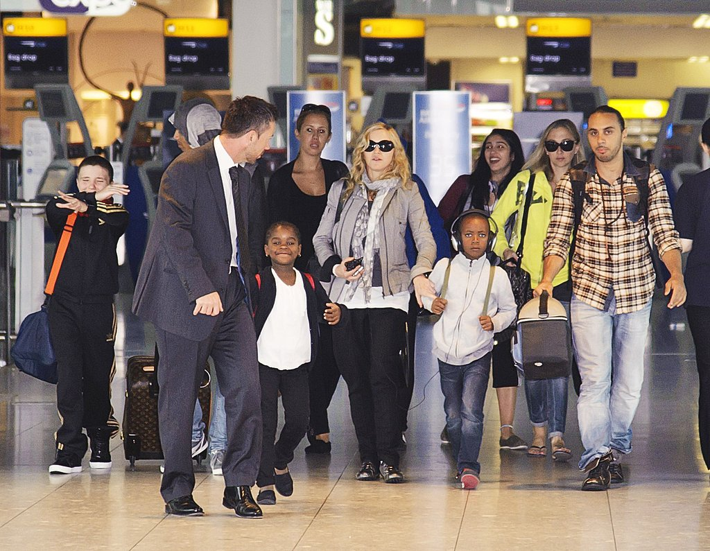 Madonna's entourage arrives in London.