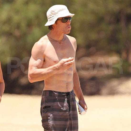 Danny Moder shirtless in a hat.