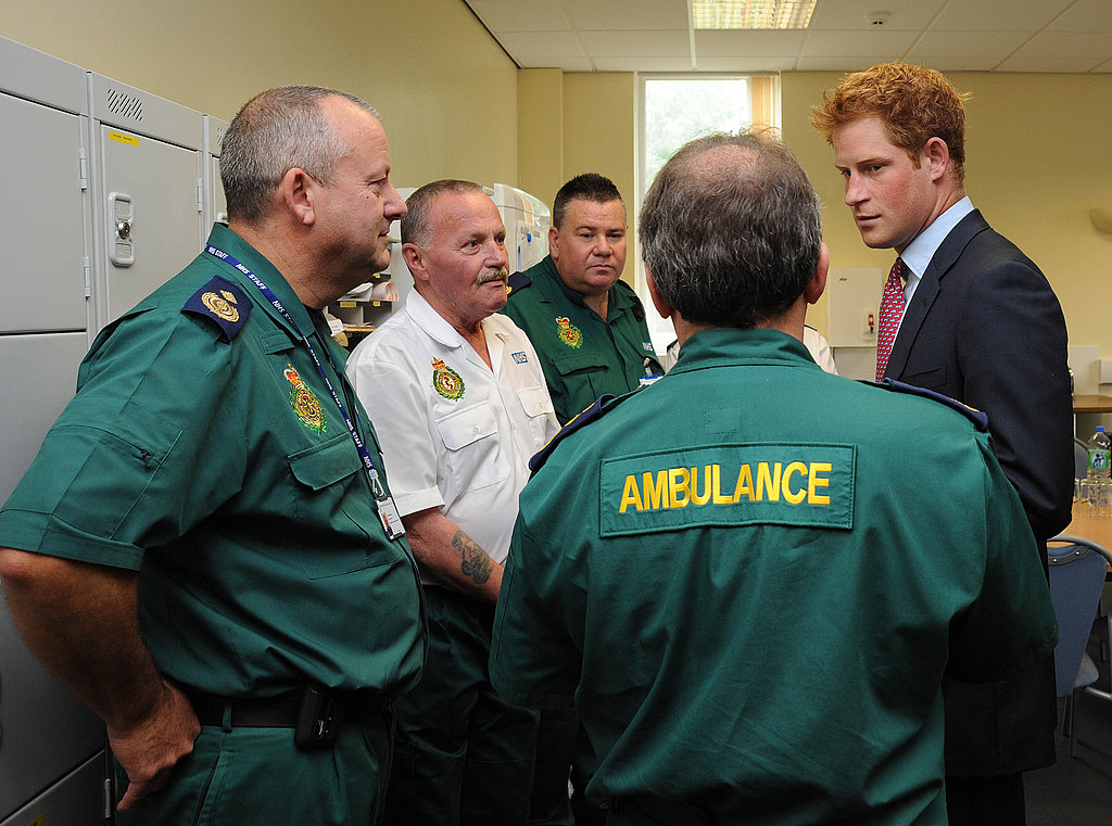 Prince Harry chats with Salford, England, emergency workers.
