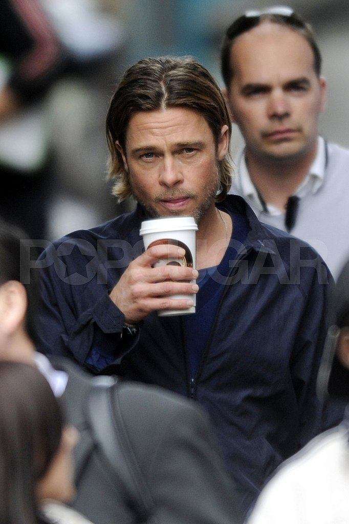 Brad Pitt drinks coffee on the Glasgow set of World War Z.