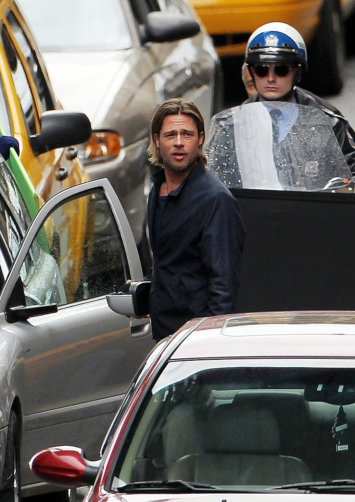 Brad Pitt preps to shoot.