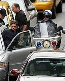 Brad Pitt gets in a car.