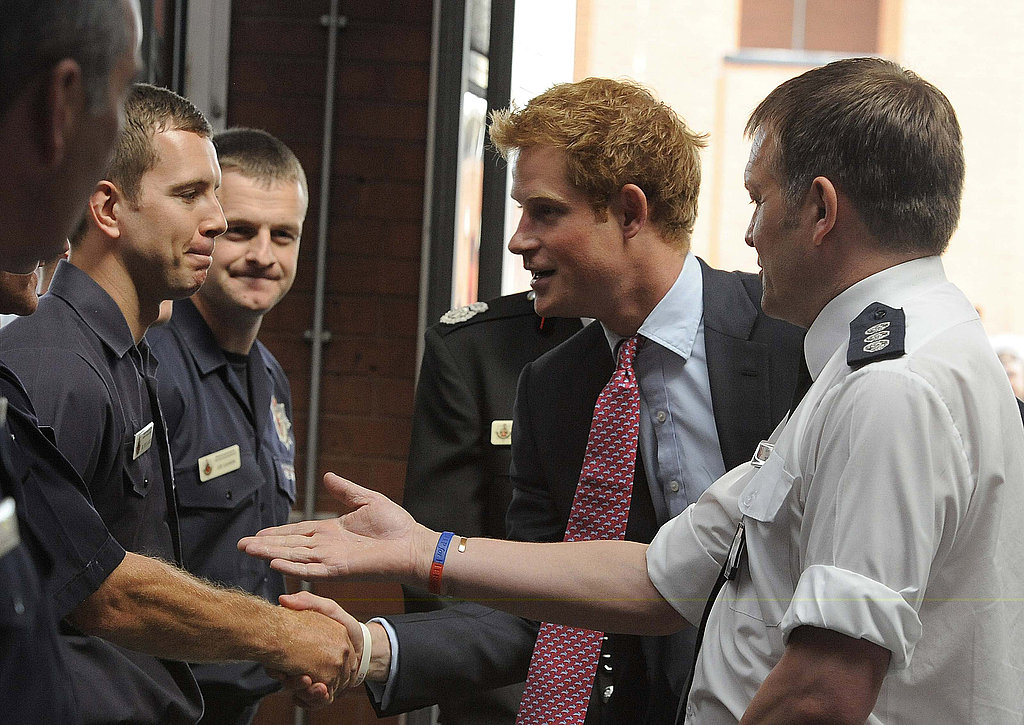 Prince Harry shakes hands.