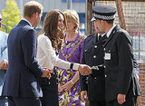 Kate Middleton shakes hands with a policeman.