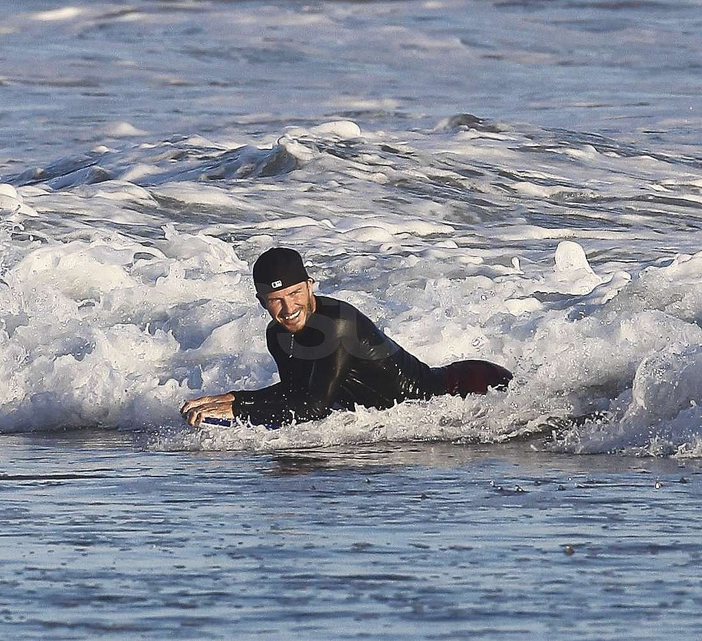 David Beckham relaxed in the water.