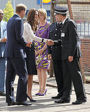 Kate Middleton greets an emergency worker.