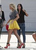 Busy Philipps wore a bright yellow skirt with Courteney Cox.
