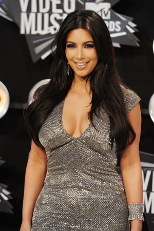 Kim Kardashian wore a gray dress.