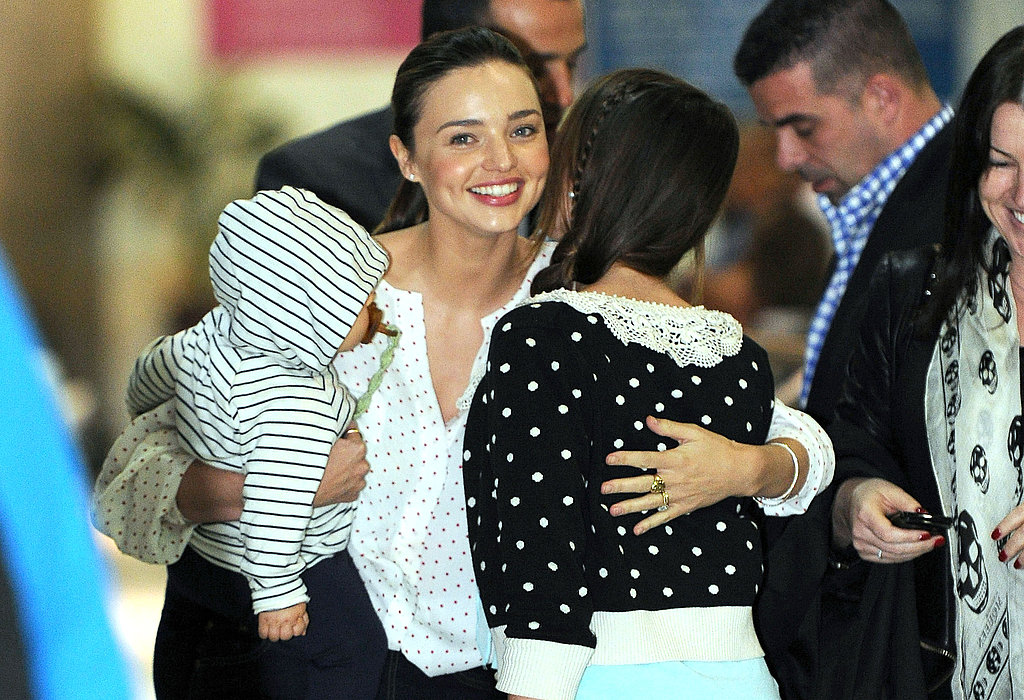 Miranda Kerr got a hug at the airport.