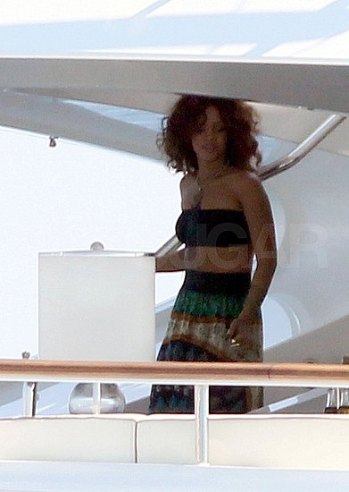 Rihanna showed her toned tummy.