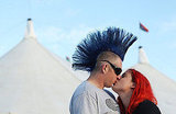 Donning brightly colored hair, this twosome shared a kiss at the Bluesfest Music Festival in Byron Bay, Australia.