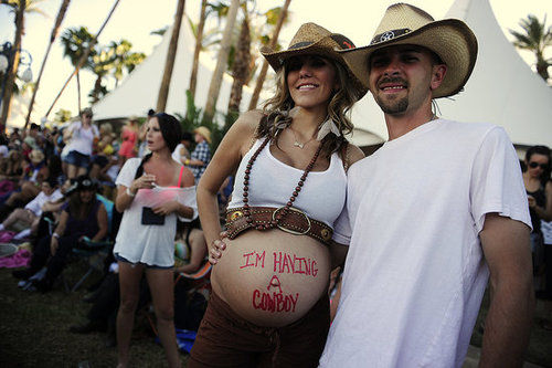 "This husband and wife let us know they were ""having a cowboy"" at Stagecoach country music festival."