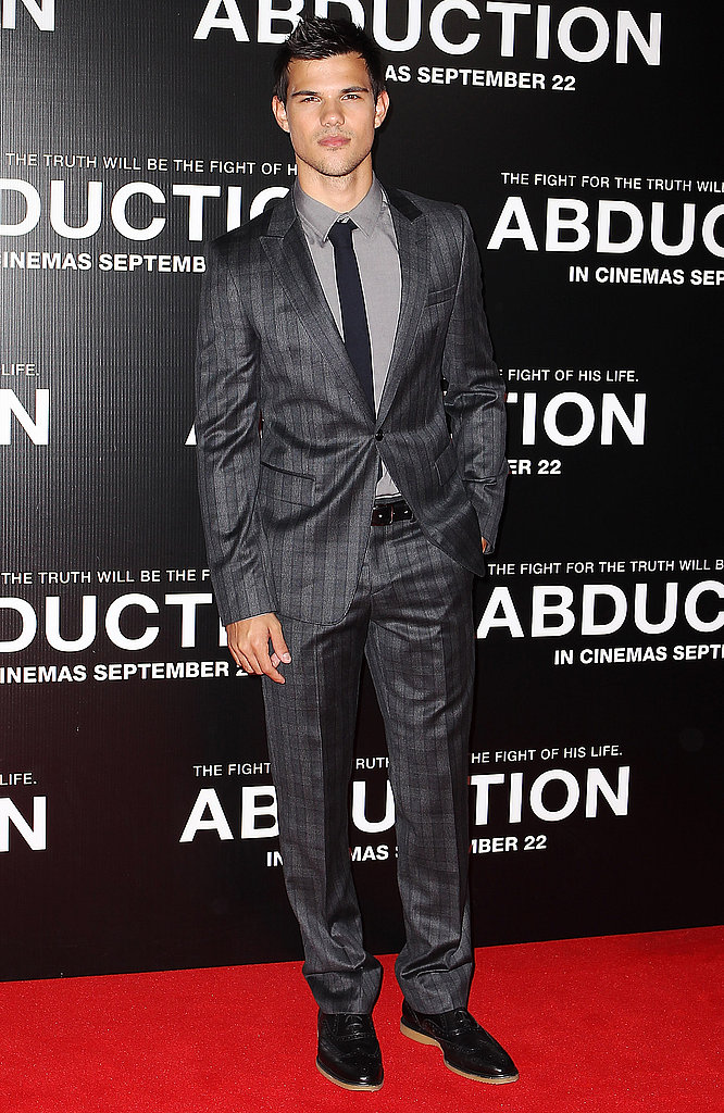 Taylor Lautner turned up the shine in his suit.