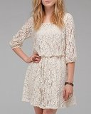A universally flattering, waist-cinching shape with beautiful white lace. Need Supply 3/4 Sleeve Lace Dress ($58)