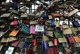 Liebesschloesser (love padlocks) were attached to a fence at the Hohenzollernbruecke bridge in Cologne, Germany.
