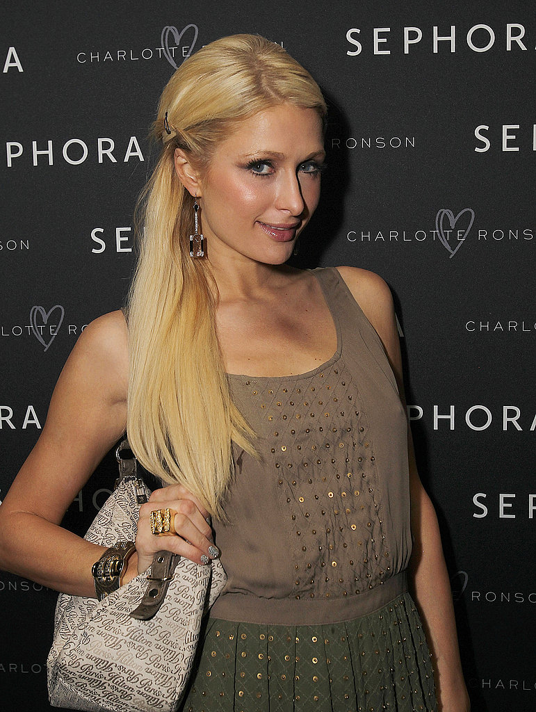 Paris Hilton posed on her way in.