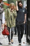 Tom Sturridge and Sienna Miller took a stroll through London together.