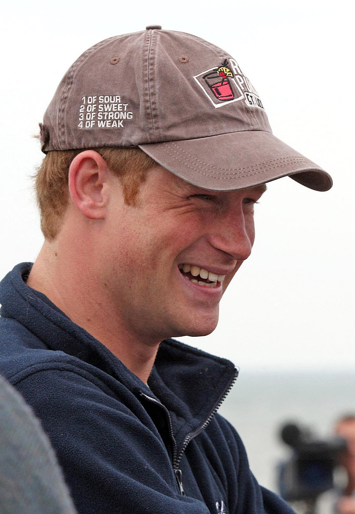 Prince Harry flashed a royal smile during his meet and greet with the participants in today's rowing exhibition.