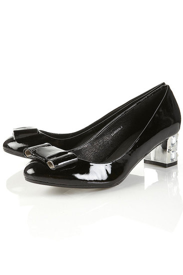 A chic and comfortable option for running around town.   Jupiter Black Patent Gem Heel Bow Pumps ($100)