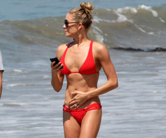 LeAnn wore a tiny red two-piece to celebrate Fourth of July in Malibu in 2011.