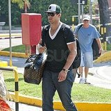 Kris Humphries carried the couple's Louis Vuitton luggage.