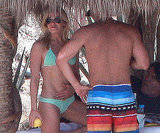 She hung out in the shade with Eddie in Mexico during August 2010.