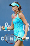 Daniela Hantuchova celebrates match point during the Western & Southern Open in Ohio, August 2011, in head-to-toe turquoise.