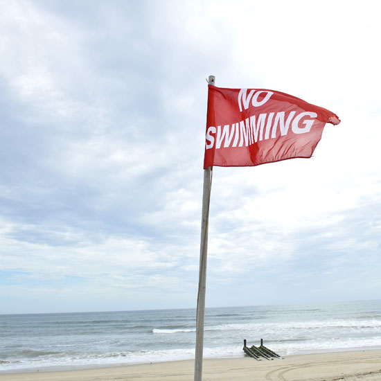 A red flag stands alone on a deserted beach in North Carolina ahead of the expected Hurricane Irene storms set to hit the East Coast.
