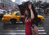A woman in NYC faces the rain ahead of Hurricane Irene arriving in New York.