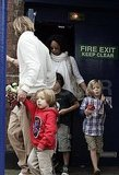 Knox Jolie Pitt and Shiloh Jolie-Pitt leave a theater in London with Pax Jolie-Pitt.