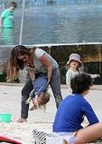 Jennifer Meyer on the beach with her kids.