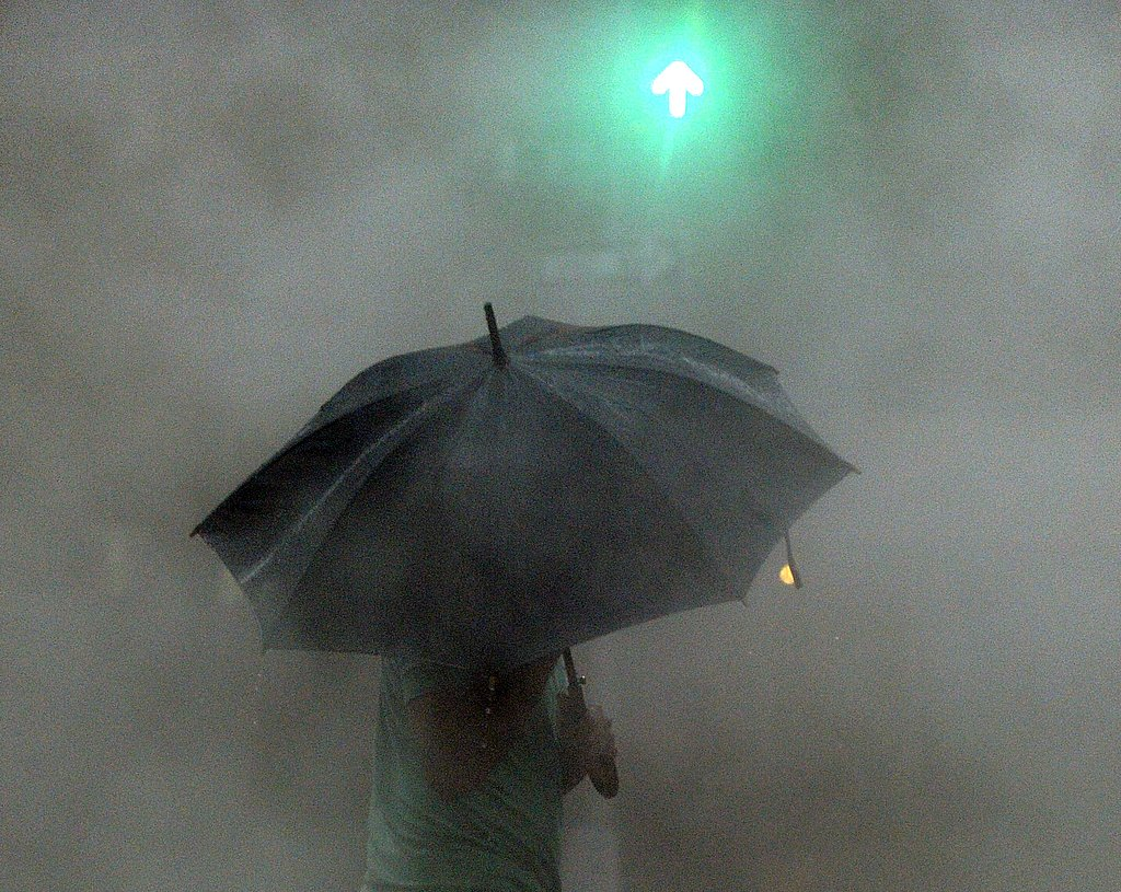 A man walks in the rain in New York during the hurricane.