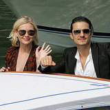 Kirsten Dunst and Orlando Bloom waved to fans during a photo call for Elizabethtown at the Palazzo del Casino in 2005.