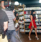 Kim Kardashian and Kourtney Kardashian shopping and filming.