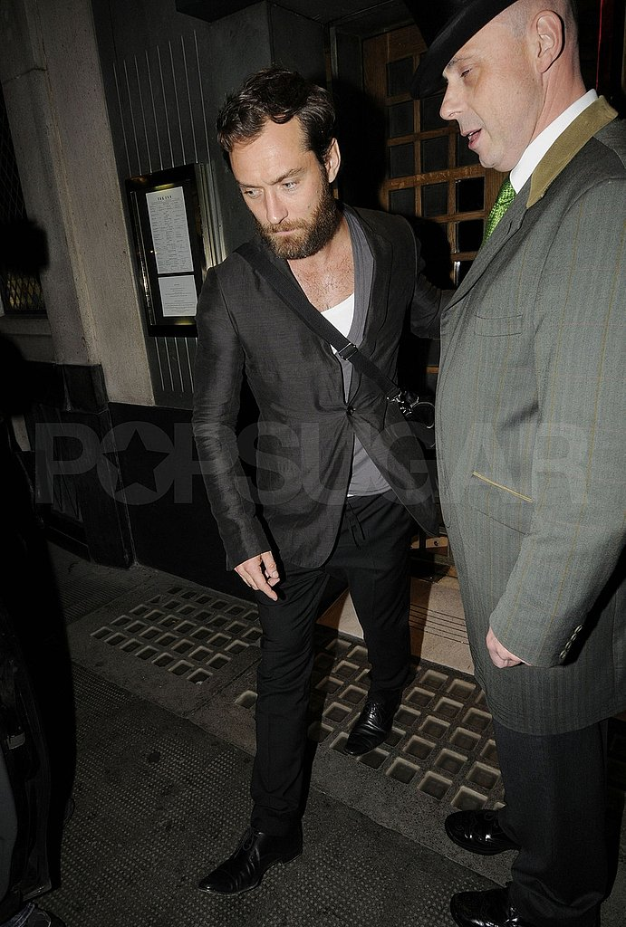 Jude Law walked past a doorman.