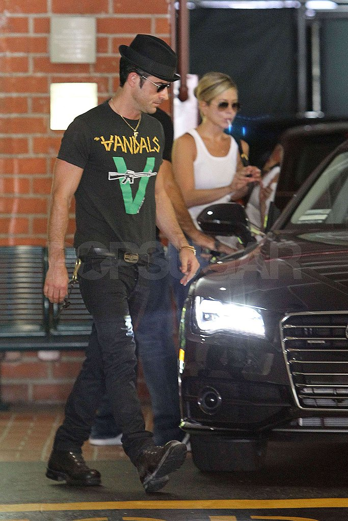 Jennifer Aniston sucked on a lollipop during an afternoon out in BeverlyHills with Justin Theroux.