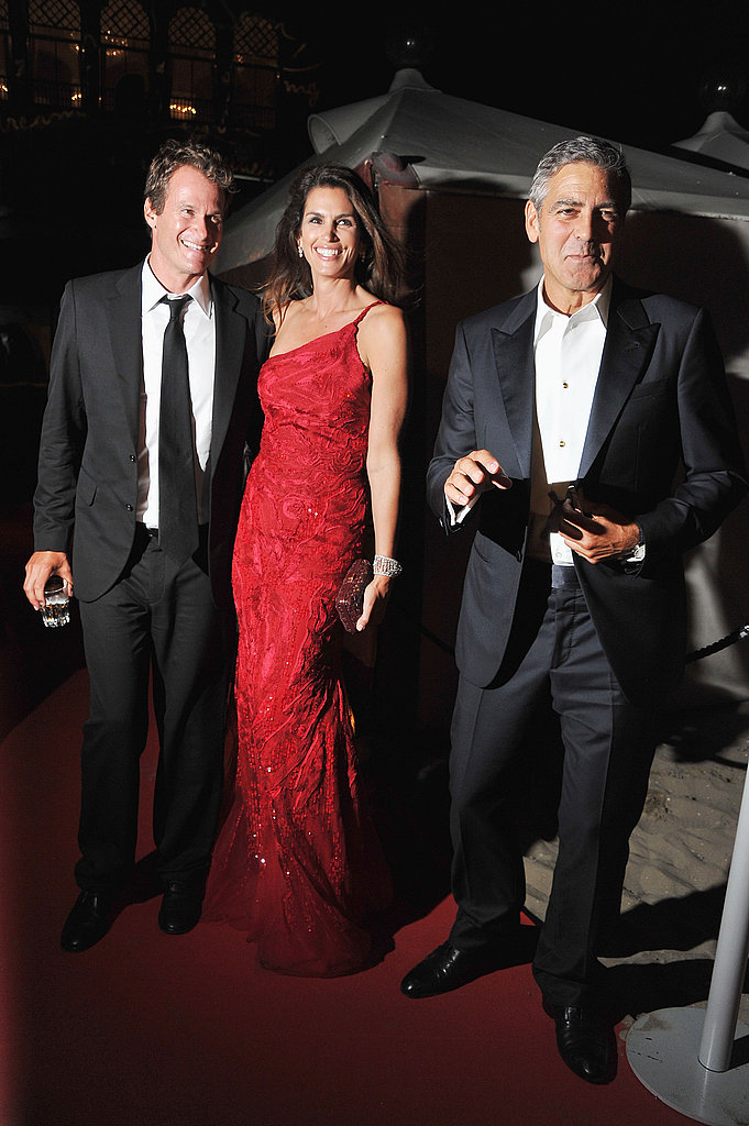 Rande Gerber, Cindy Crawford, and George Clooney at the Venice Film Festival opening night dinner.