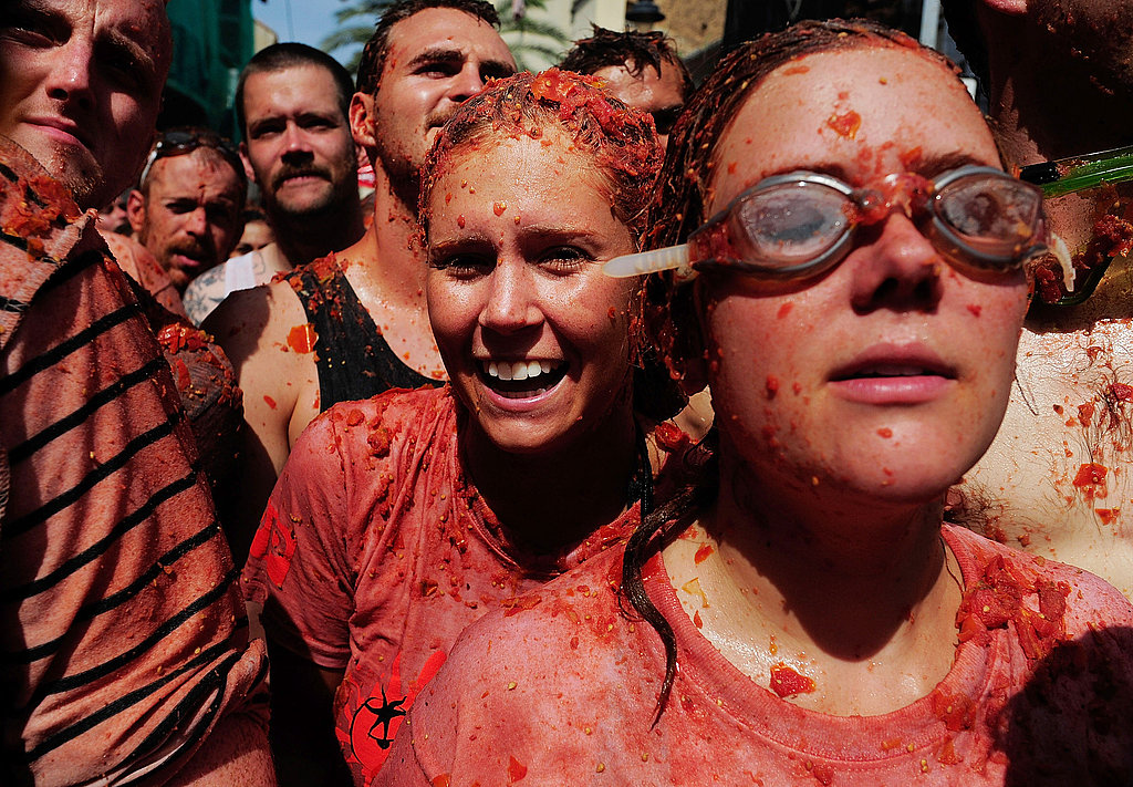 Goggles make a smart accessory at the Tomatina festival.