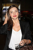 Miranda Kerr wears red lipstick.