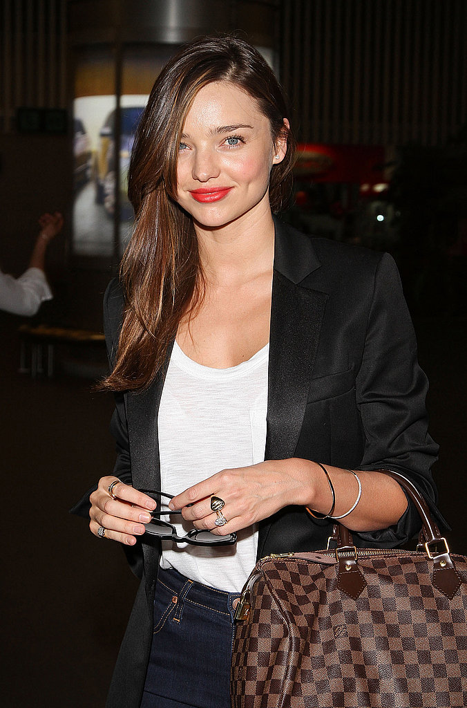 Miranda Kerr with a Louis Vuitton bag.