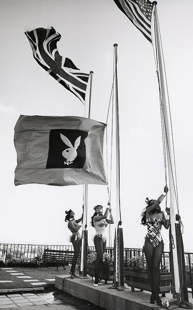 Playboy bunnies raise the flag at the London club.