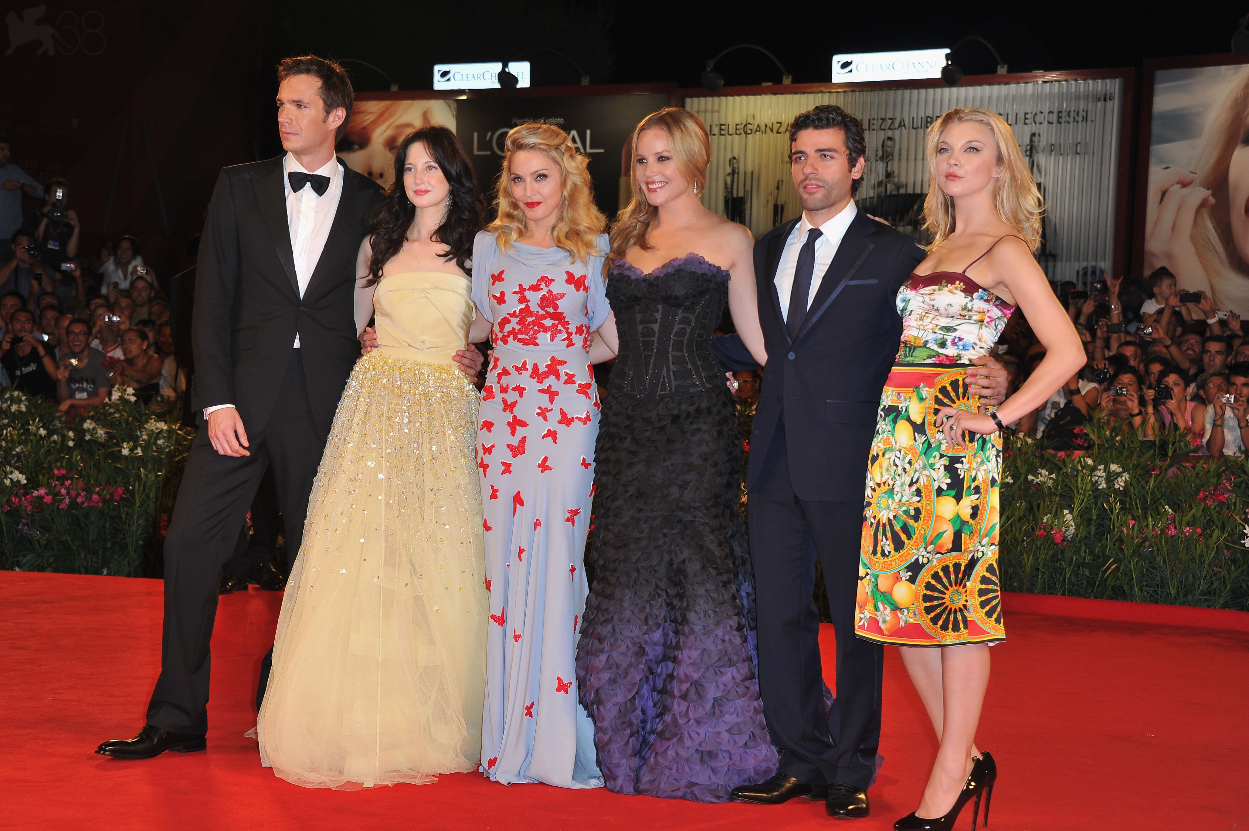 The W.E. cast and director Madonna line up on the red carpet.