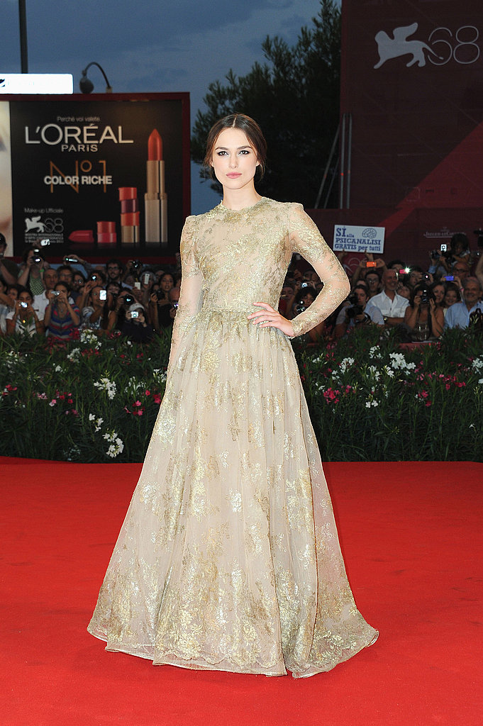 Keira Knightley looked gorgeous in a gold, long-sleeved gown by Valentino Couture.