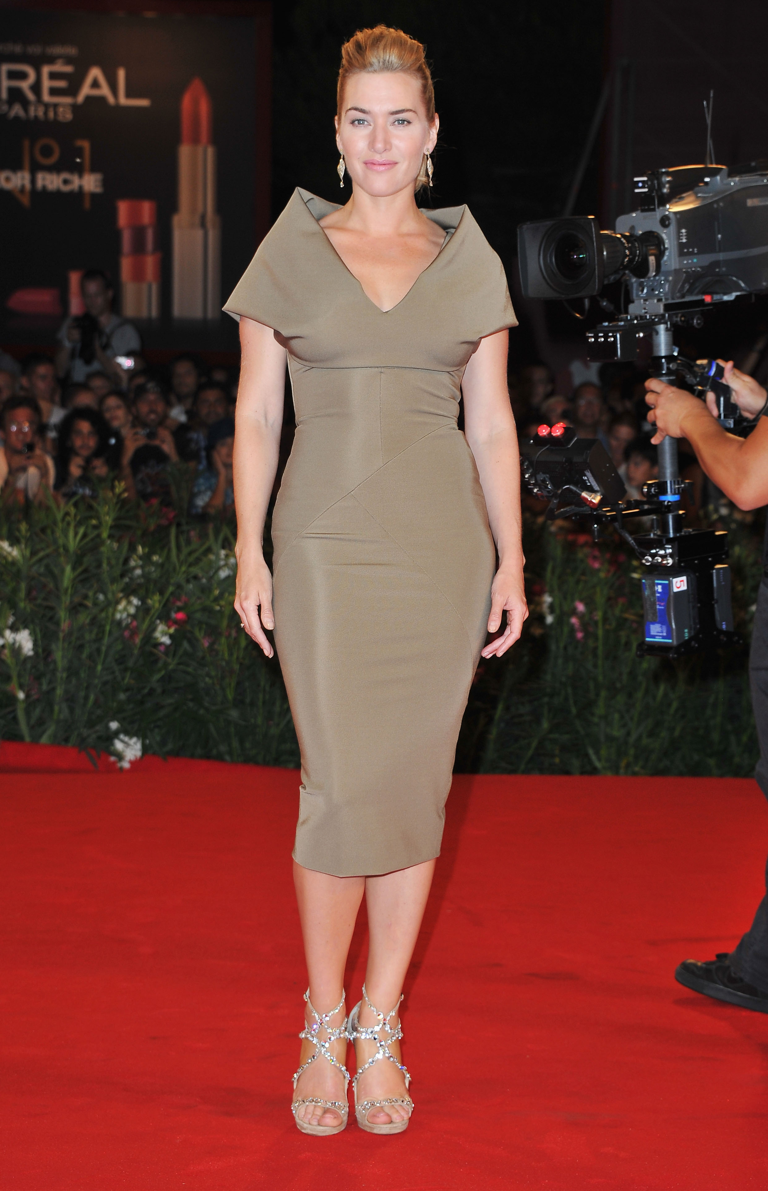 Kate Winslet in a structured dress by Victoria Beckham.