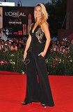 Bar Refaeli showed off her curves in a sexy black jumpsuit by Emilio Pucci.