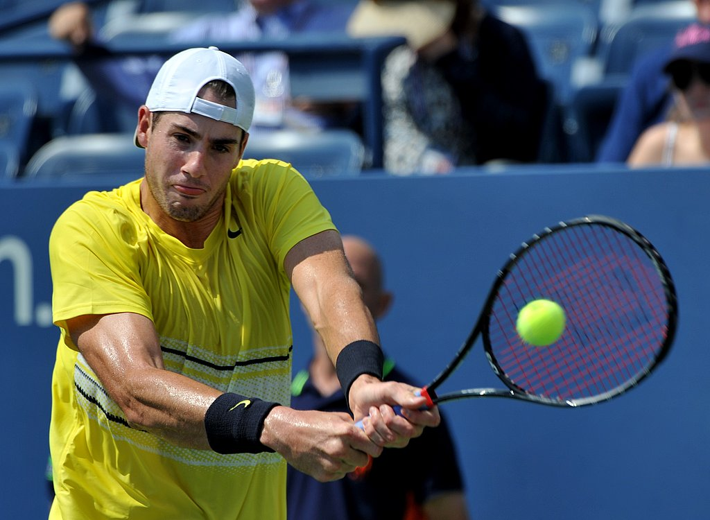 John Isner returns a shot to fellow American Robby Ginepri on Friday.